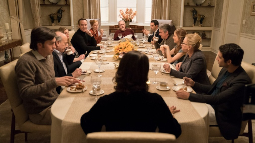 Image is from the TV Show 'Succession'. A large, wealthy family has dinner together at a dining table.
