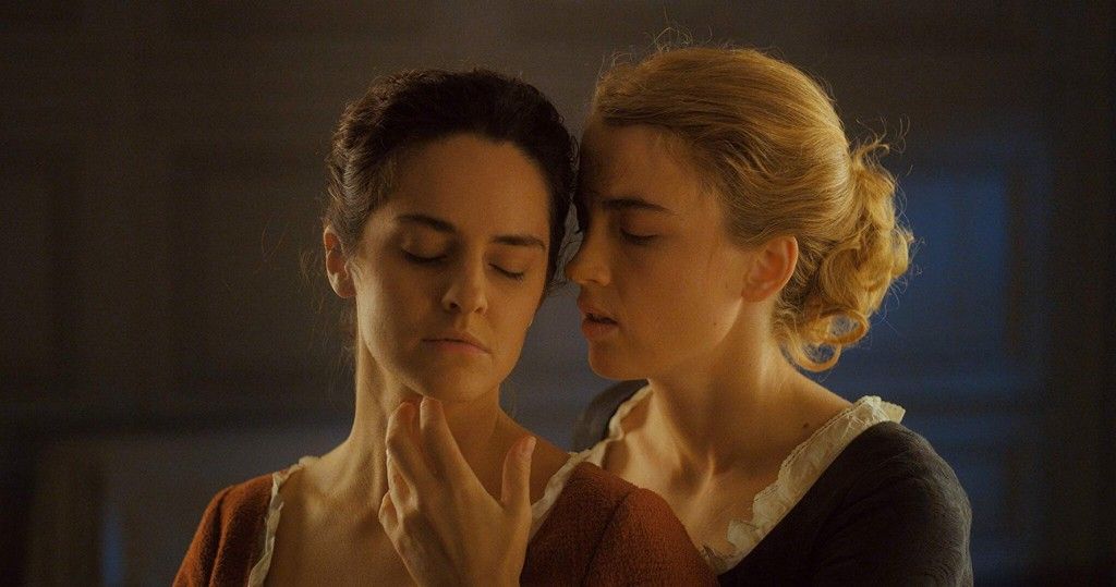 Image from the film Portrait of a Lady on Fire. Héloïse caresses Marianne's chin.