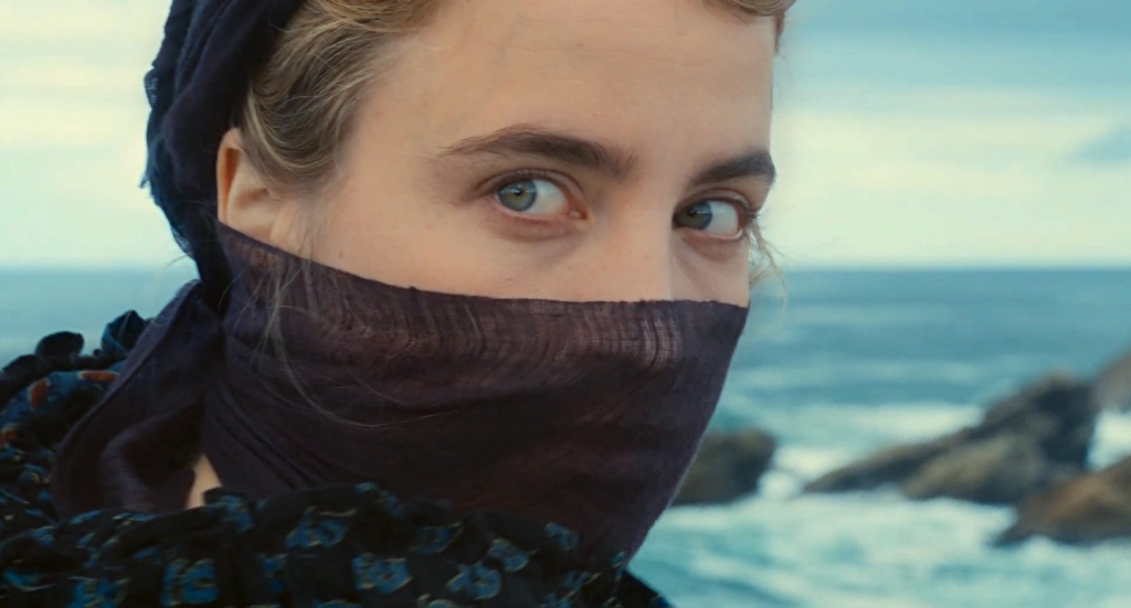 Image is from Portrait of a Lady on Fire. Héloïse face is covered with a scarf, only her eyes are visible.