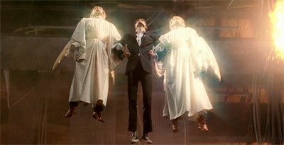 The Tenth Doctor is lifted through the broken space Titanic by two Heavenly Hosts in ''Voyage of the Damned'