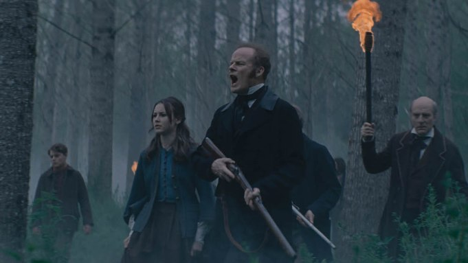 Alistair Petrie and Amelia Crouch lead a search party in the woods