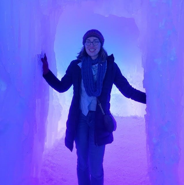 Image of Hayley Paskevich, who is stood in an ice corridor, which is coloured purple.