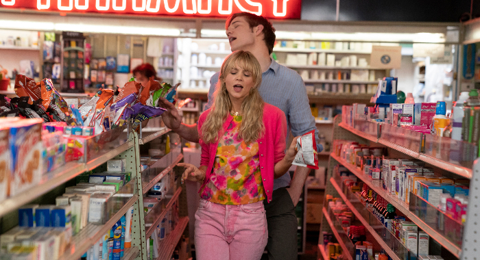 Ryan and Cassie dance together in a convenience store.
