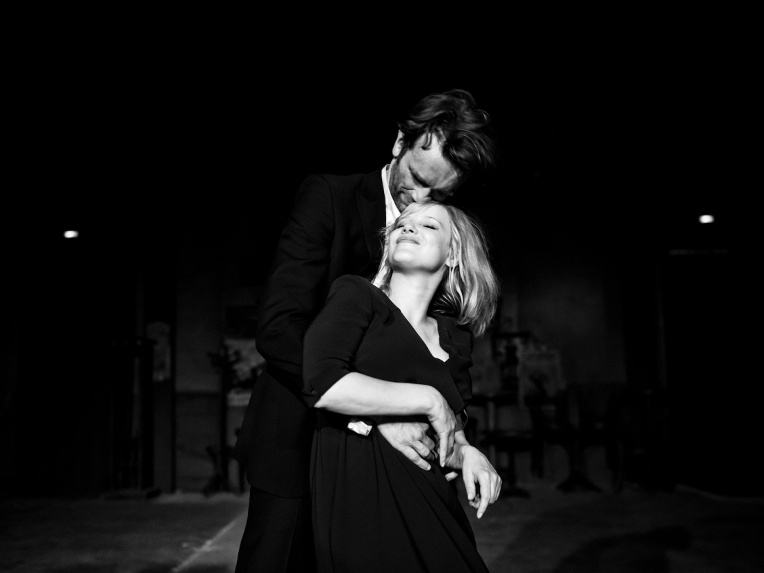 Image is from the film 'Cold War' (2018). Wiktor and Zula dancing in the jazz club, a spotlight is focused on them as they smile. The image is in black and white.