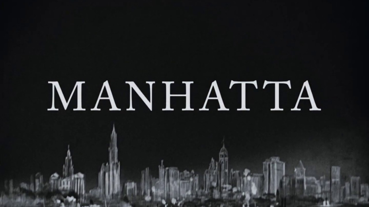 Image is from the documentary 'Manhatta' (1921). Black and white image of the New York skyline with the film's title, Manhatta, in large text above it.