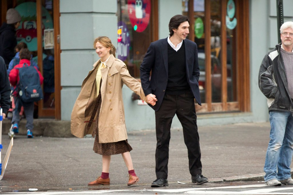 A smiling Mia and Jude hold hands on the street