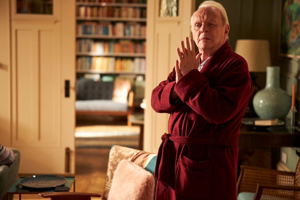 Anthony, portrayed by Anthony Hopkins, standing in his living room, wearing a red robe.