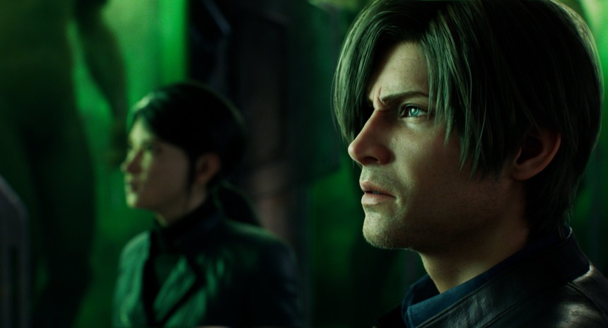 Leon Kennedy, with short hair and stubble, is seen in profile view. Shen May is in a jacket and out of focus in the background. They're observing something, their environment lit by a green tint