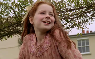 Smiling Pollyanna raises herself up and looks into an unseen distance